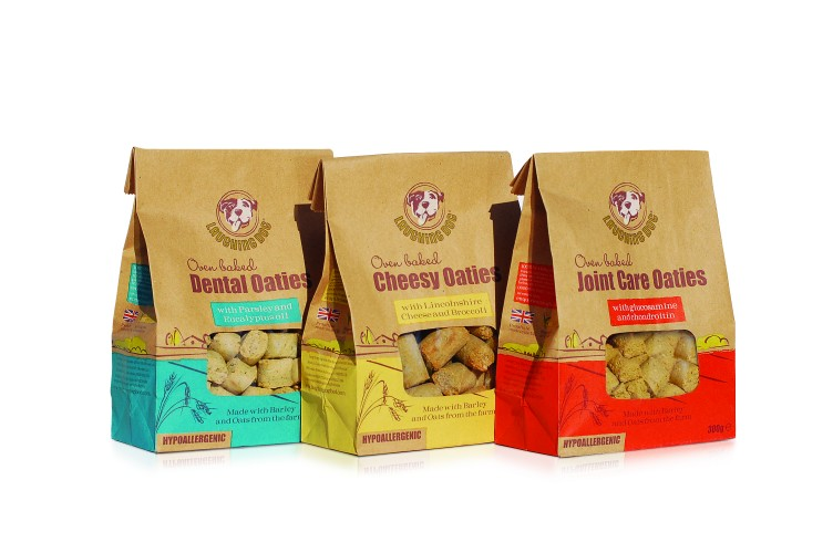 3 Bumper Packs of 3 x NEW Oven Baked Oaties & 15kg Bag Of Natural Complete from Laughing Dog To Win!